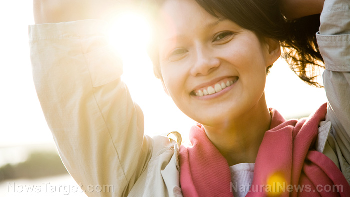 Woman-Smiling-Sunset-Vitamin-D-Outdoors