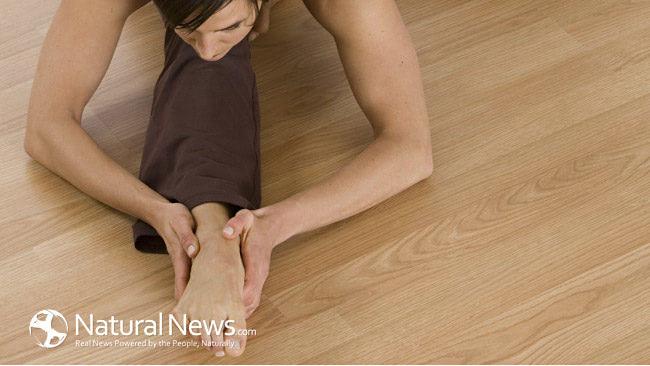 Woman-Yoga-Studio-Floor-Stretch-Pose-650X433