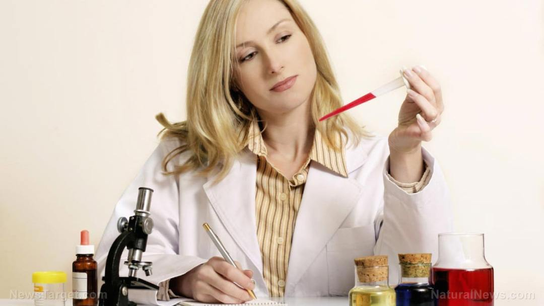 Woman-Chemist-Testing-Lab-Chemicals