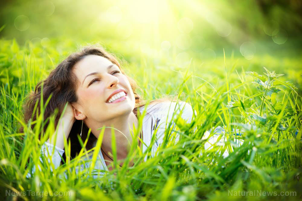 Woman-Smile-Healthy-Lying-Grass-Down-Outside