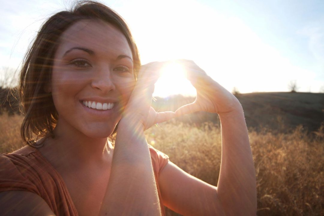 Woman-Vitamin-D-Sun-Nature-Smile