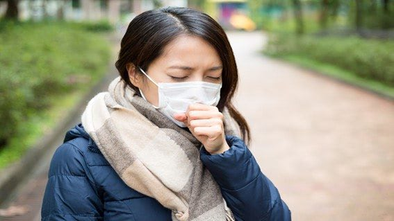Asian girl with mask coughing